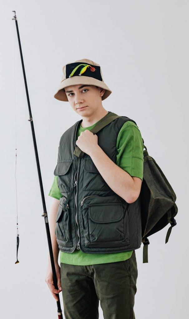 boy wearing a fishing vest